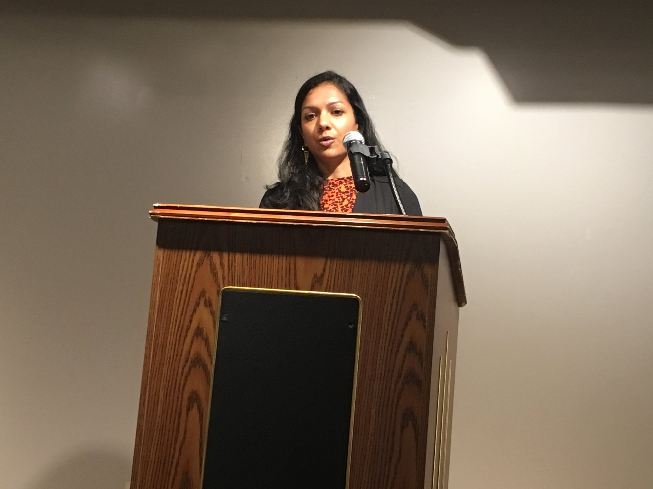 Nina Sudhakar reads at Gibbs-Morrison Cultural Center.