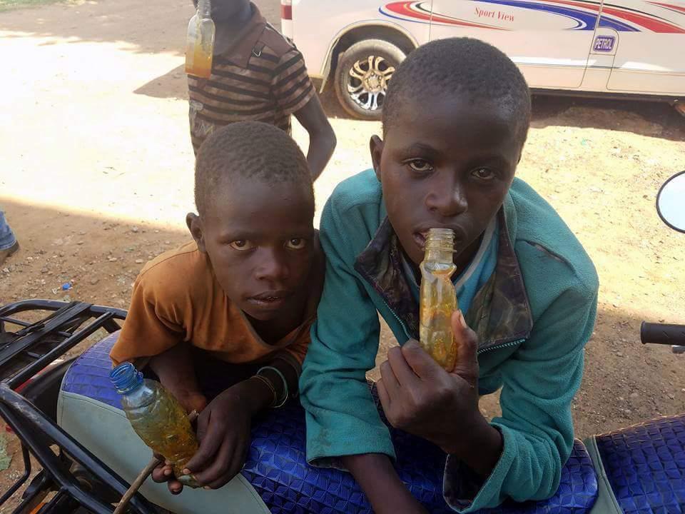 Eugene (left) with Dan, both holding glue bottles.