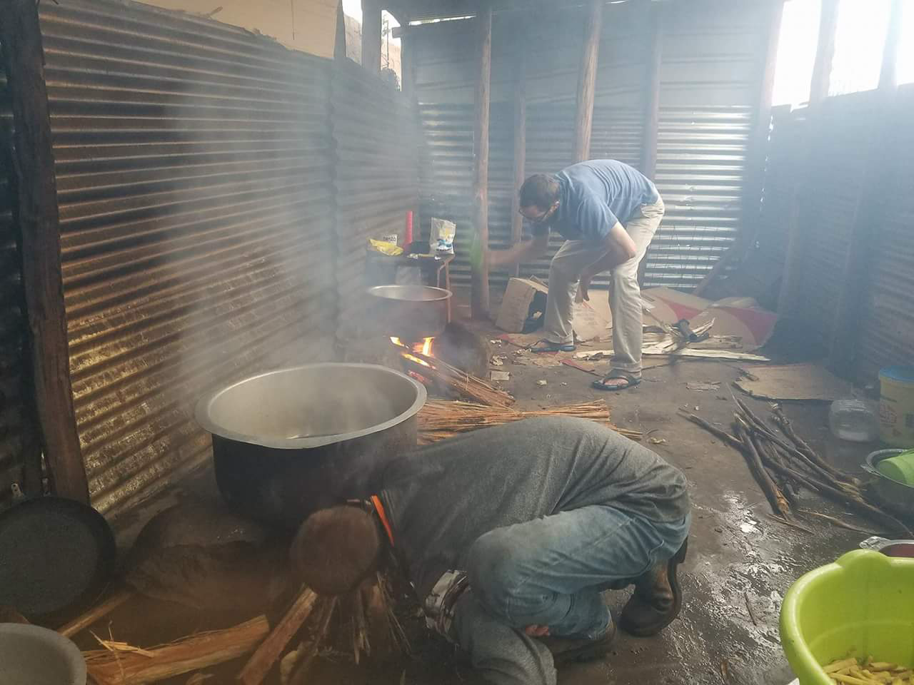 """Karson and Jeff cooking chips (french fries) in our jikoni (Swahili for """"kitchen"""")"""