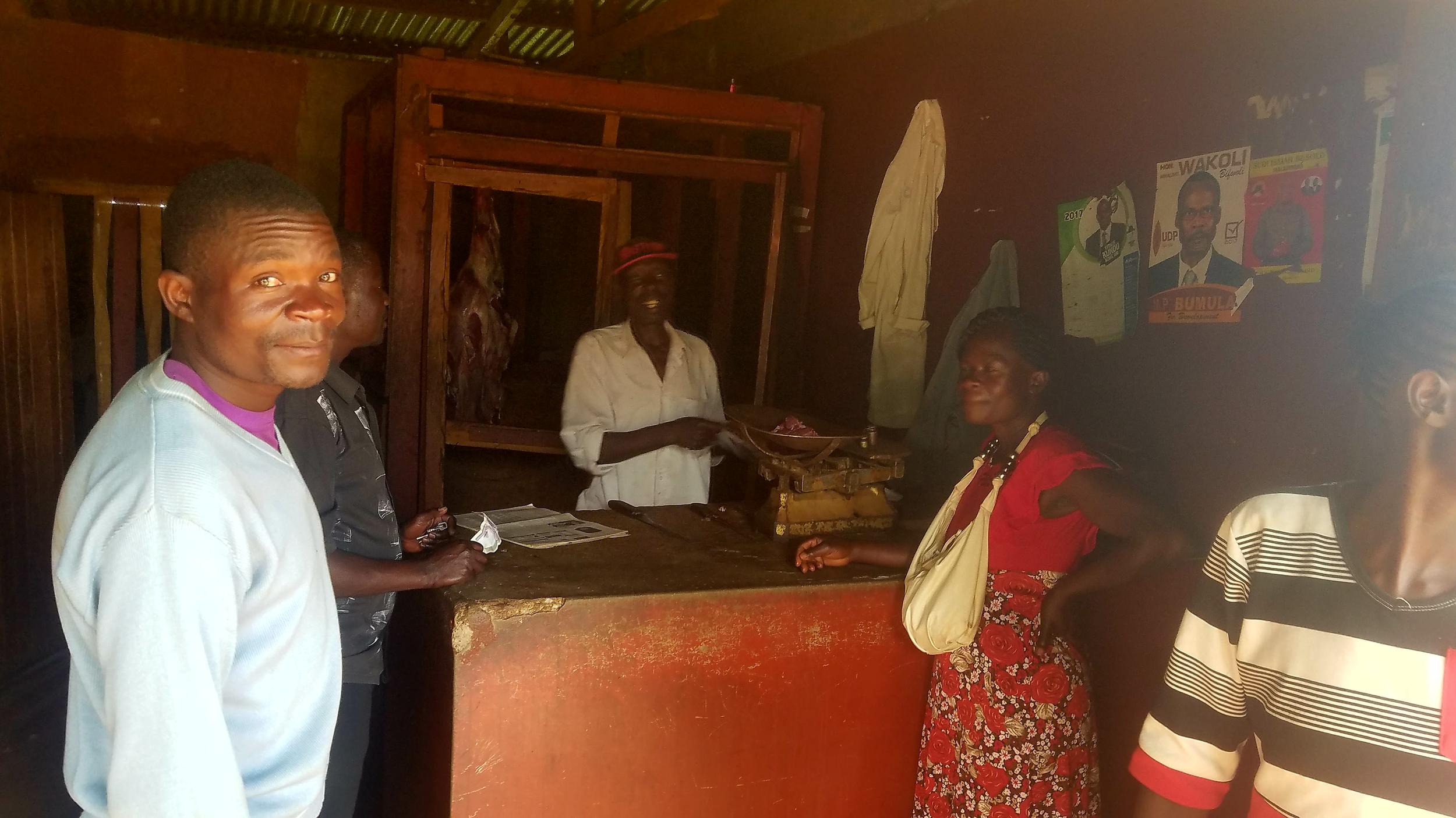 Folks buying nyama ya ng'ombe (beef) at the local butchery.