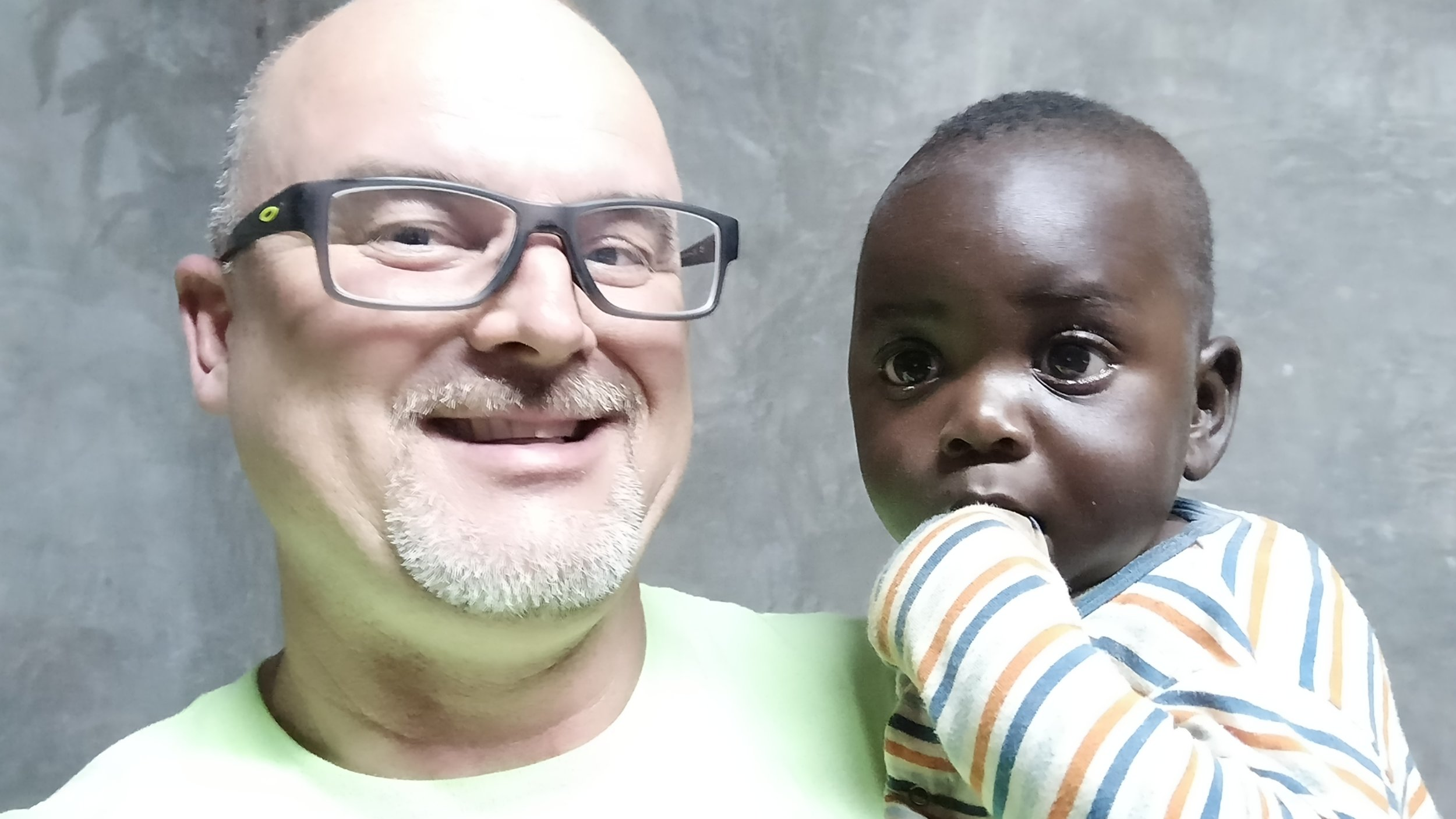 Me and our youngest member of Mercy Home, baby Zeke.