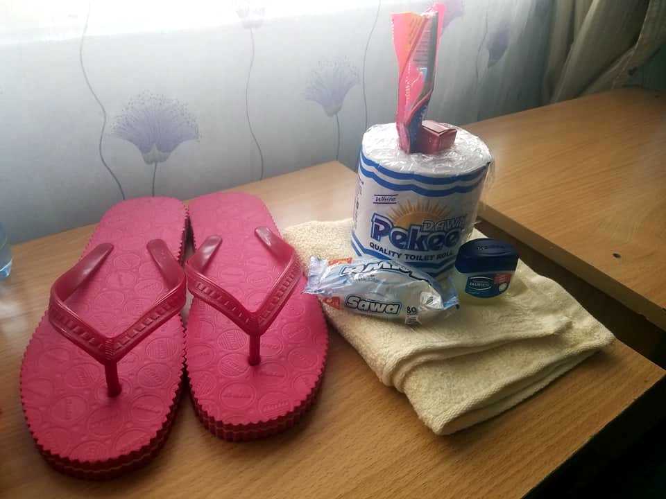Amenities😂. Slippers, toilet paper, toothbrush, Colgate (any brand of tooth paste is Colgate here), body soap, mafuta (Vaseline) and a bath towel (it is the size of a hand towel). Oh and if you run out of any of these things during your stay you are required to purchase your own 😂😂😂.