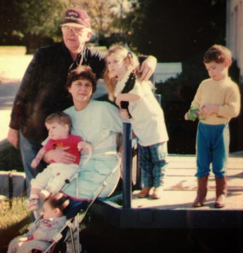 Keith & Rowena with their grandchildren 1988 ish. (That's me in the red shirt in Grandma's lap! )