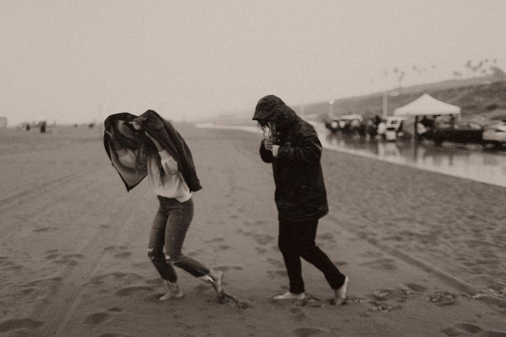 rainy beach engagement session_0551.jpg