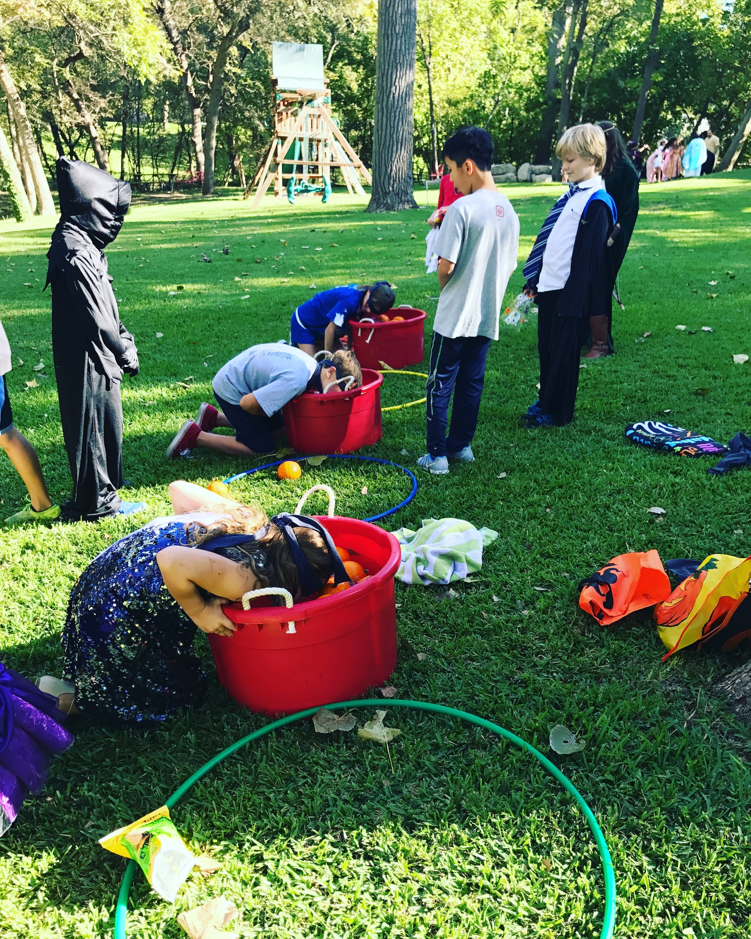 Bobbing for pumpkins at a Halloween inspired birthday party