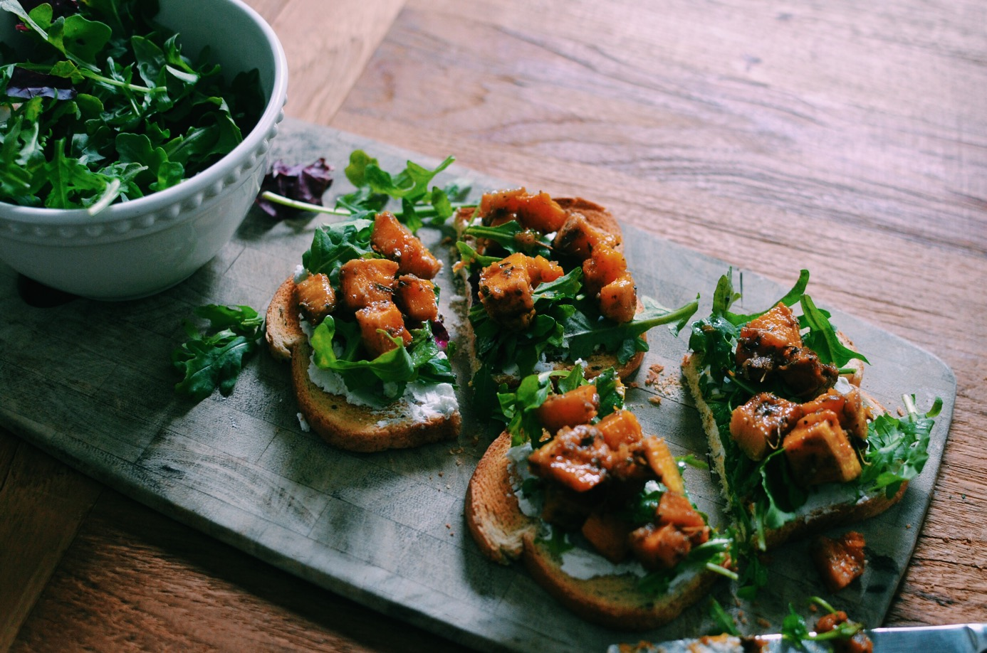 Jerk Butternut Squash Crostinis with Arugala and Goat Cheese