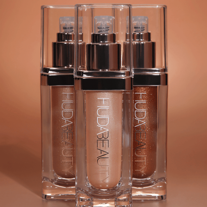 "Huda Beauty Debuts ""Liquid Pantyhose"" Body Highlighter With a Whopping 30 Percent Shimmer"