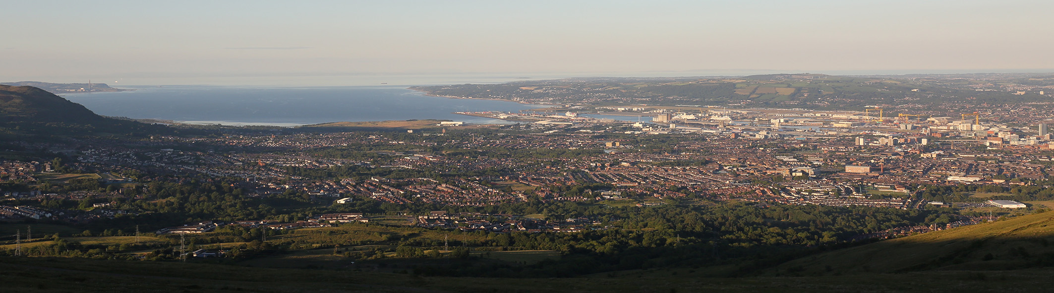 Belfast in the evening sun viewed from Divis