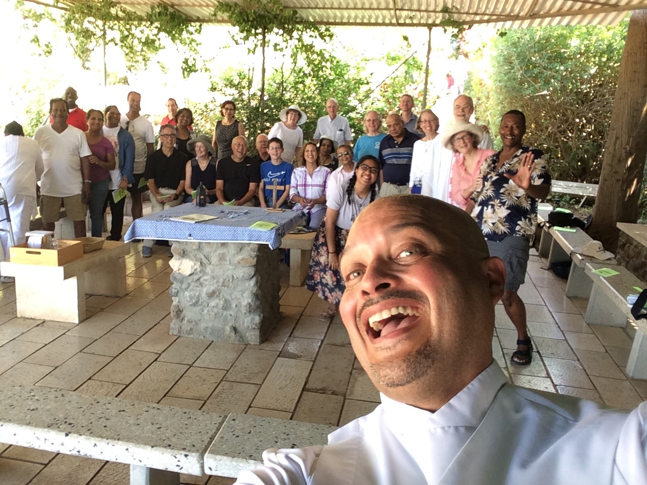 A selfie by our leader, Deacon Curtis Turner, as we celebrate after our Mass at the Church of the Beatitudes.