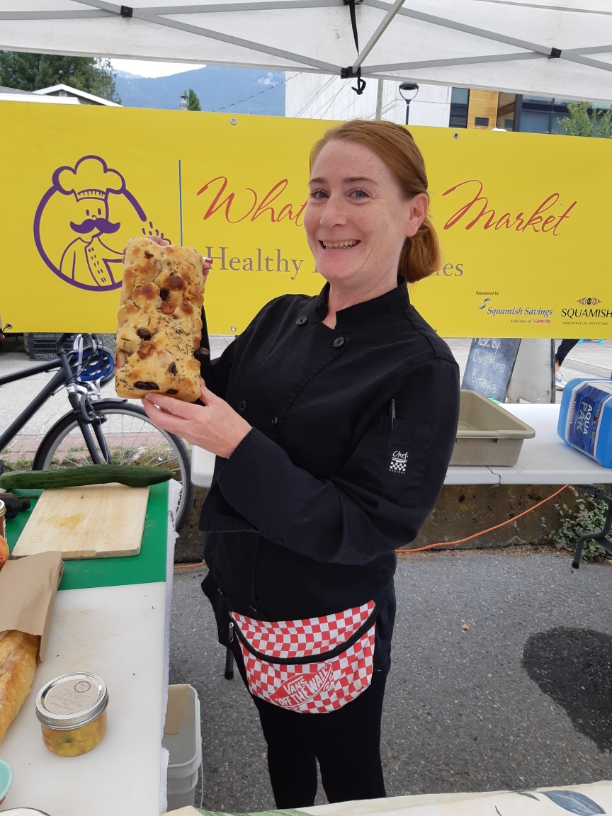Here we have Chef Moe Ryan of Moe's Pantry. One of the first vendors of the Squamish Farmers' Market many years ago. The chef's recipe for what was made can be found here:  https://www.squamishfarmersmarket.com/moeryandinnerplatter   Moe made a beautiful, fresh, local market dinner platter up with many different vegetables from local Nutrient Dense Farm in Squamish, and Plenty Wild Farms and Laughing Crow Organics from Pemberton, her homemade jam and balsamic vinegarette, as well as some grilled bread from Rising Knead Bakery from Whistler.