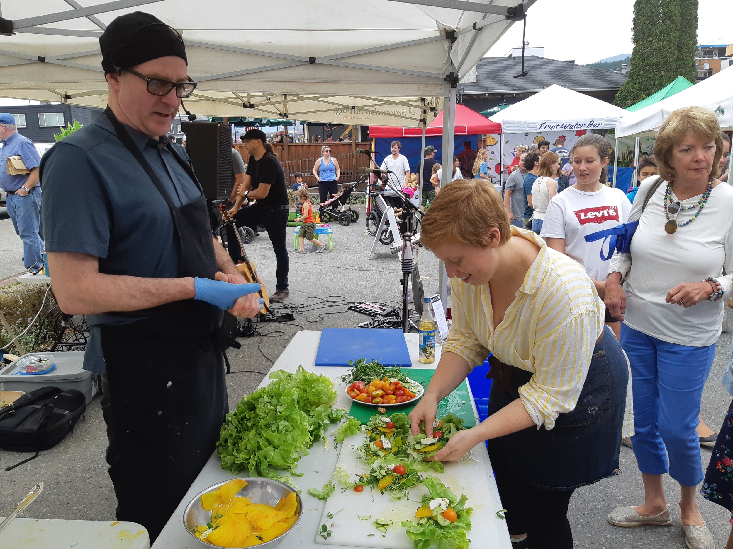 Jeramy Duckworth, head Chef and co-owner of Saha Eatery joined the market on August 31st, 2019 to demonstrate his cooking skills. Jeramy hails from Ontario originally whose passion for flavourful food led him to teach himself how to cook. He honed his skills as a line cook, working his way up the kitchen ladder, so-to-speak and made his way across the country to Victoria, then Vancouver and eventually to Squamish with a friend who asked him to open Saha with him.  At the market Jeramy created a beautiful golden beet salad with garlic scape cummulus vegan cheese. You can find the recipe on our recipe share  here .