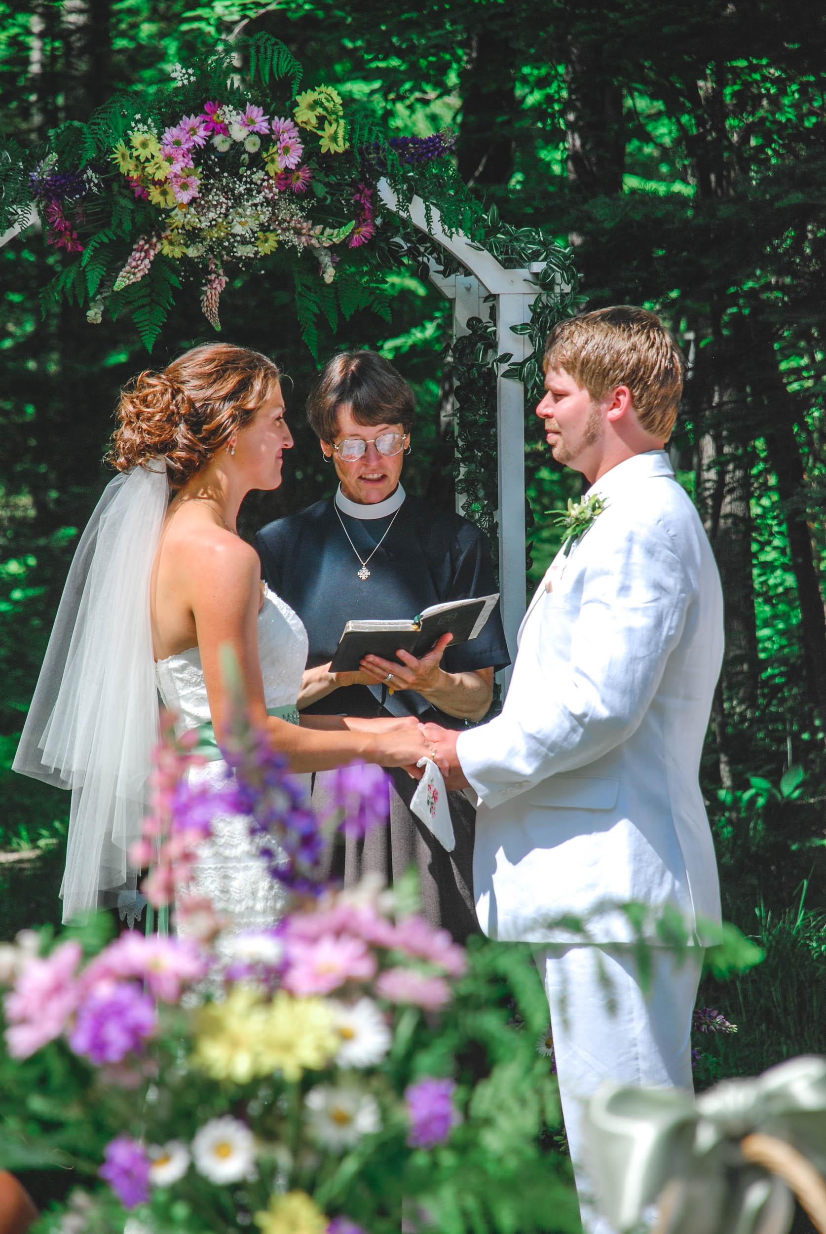 Backyard Wisconsin wedding vow exchange