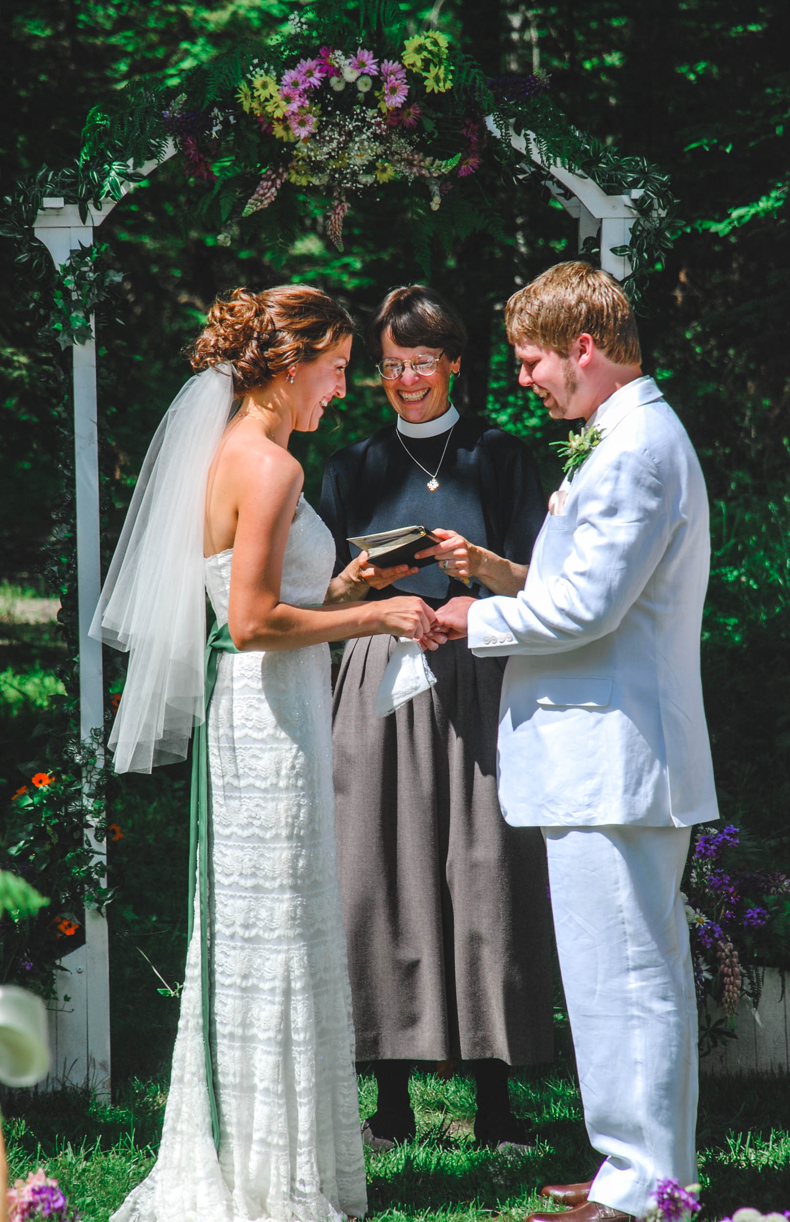 Exchanging the rings in an outdoor summer backyard Wisconsin wedding