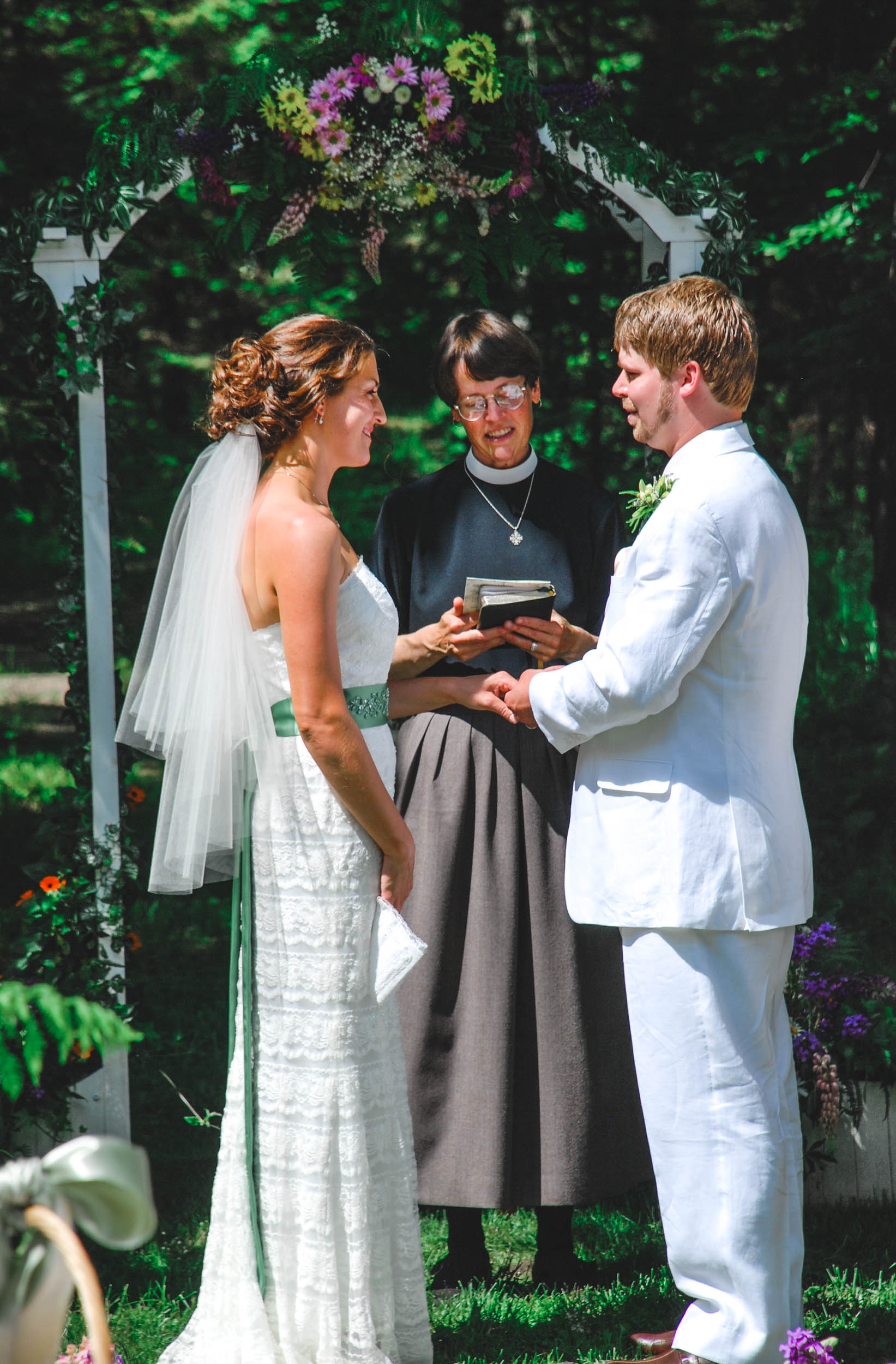 Backyard Green Bay, WI wedding ring exchange
