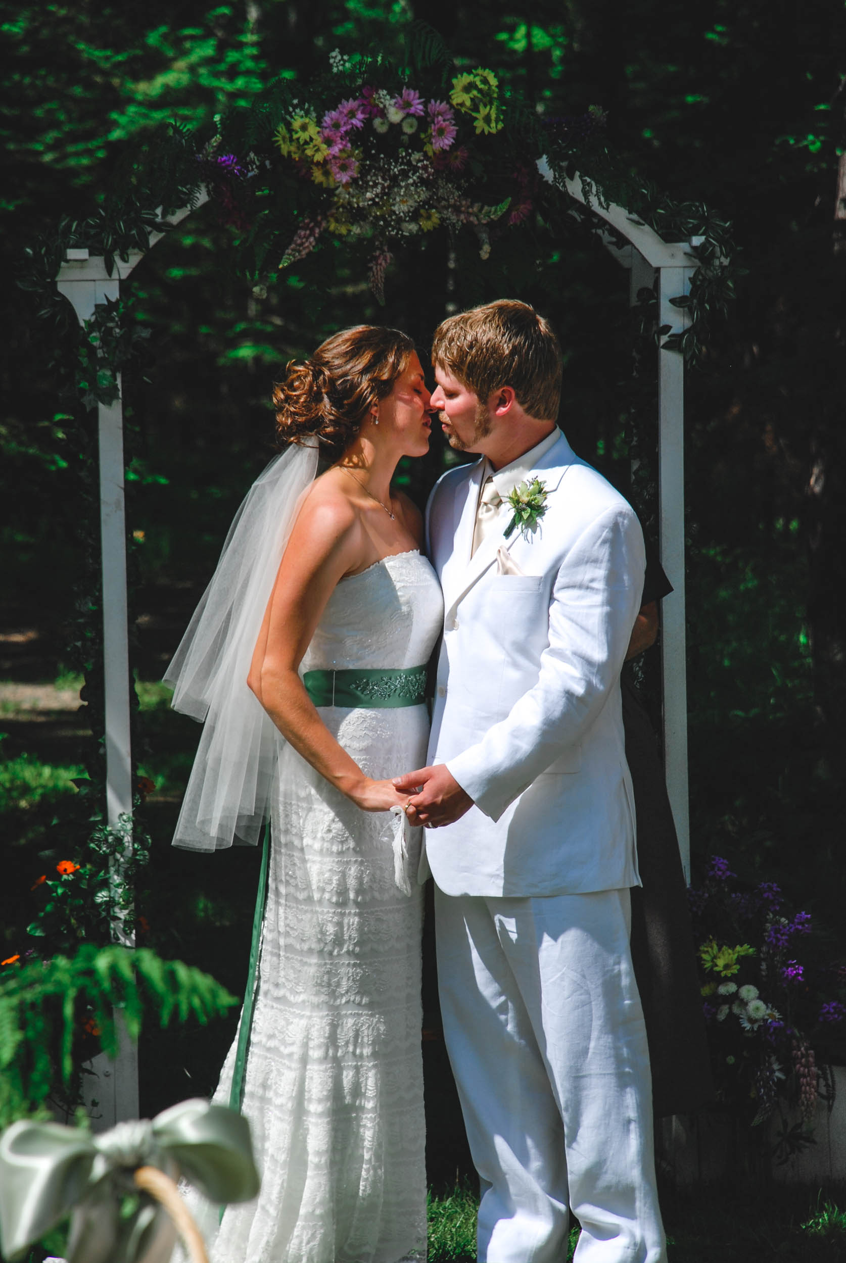 First kiss as husband and wife outdoor summer WI wedding