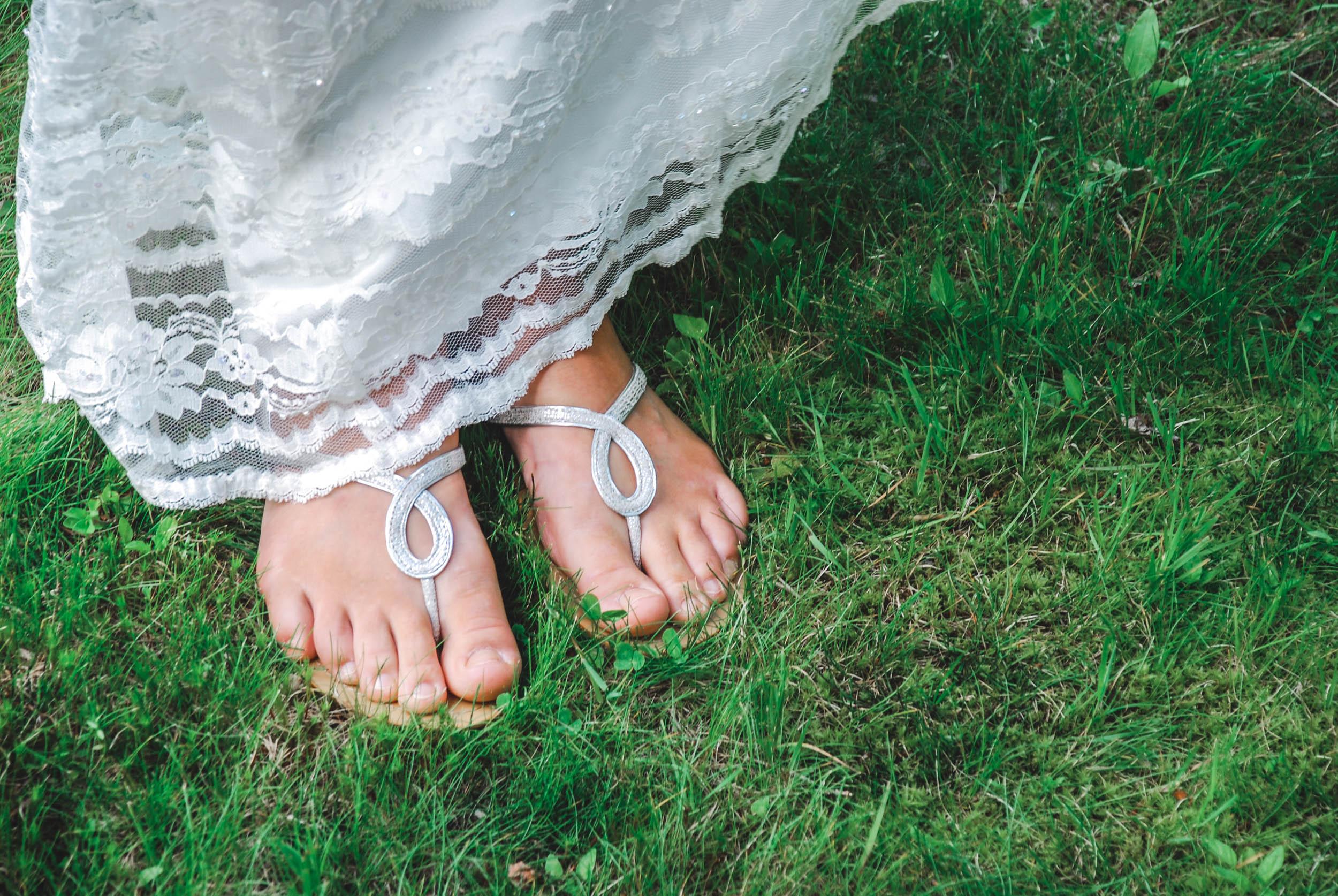 Wisconsin bride's feet in grass