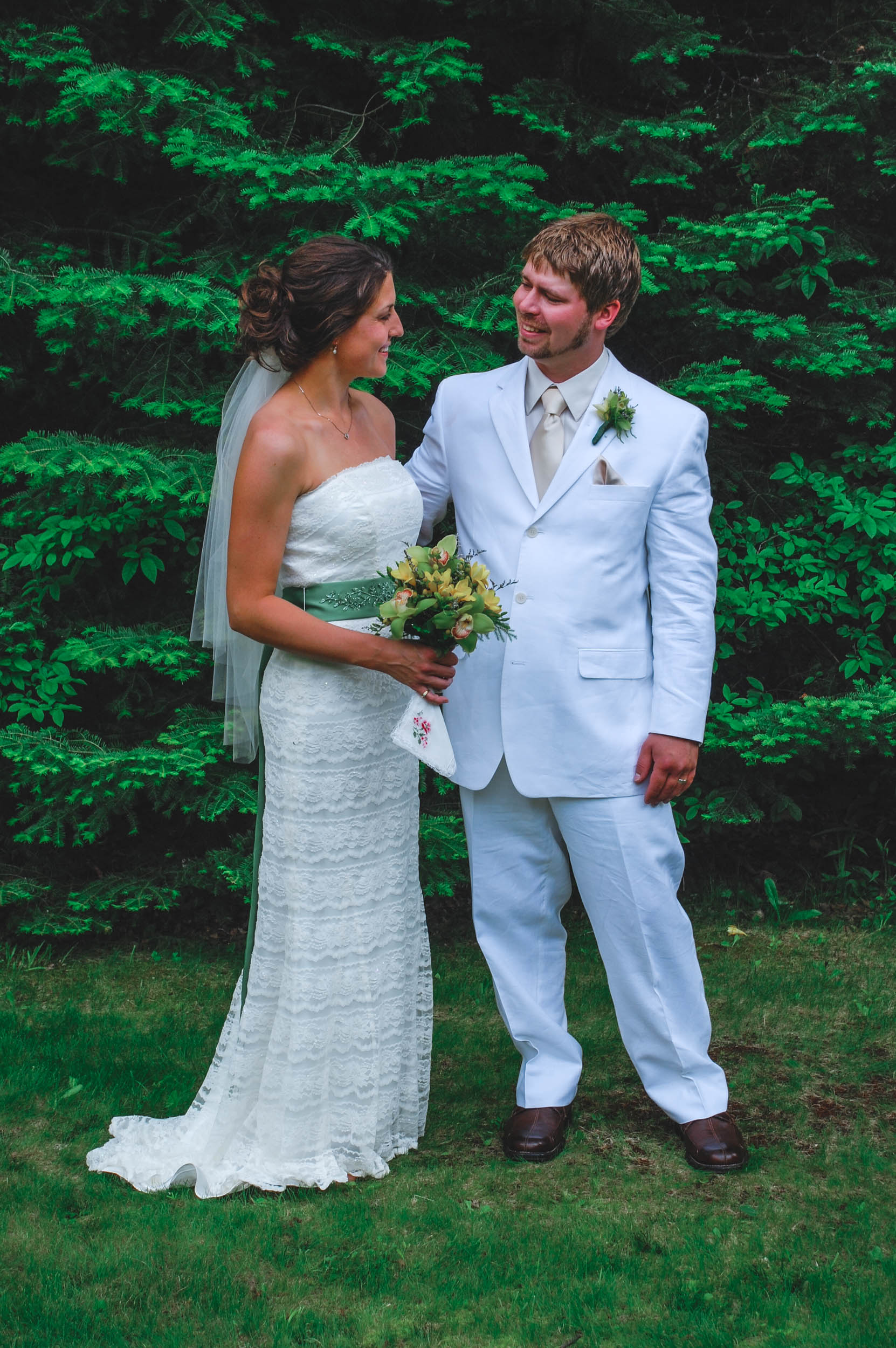 Bride and groom share a moment together after their backyard summer wedding in the Wisconsin countryside
