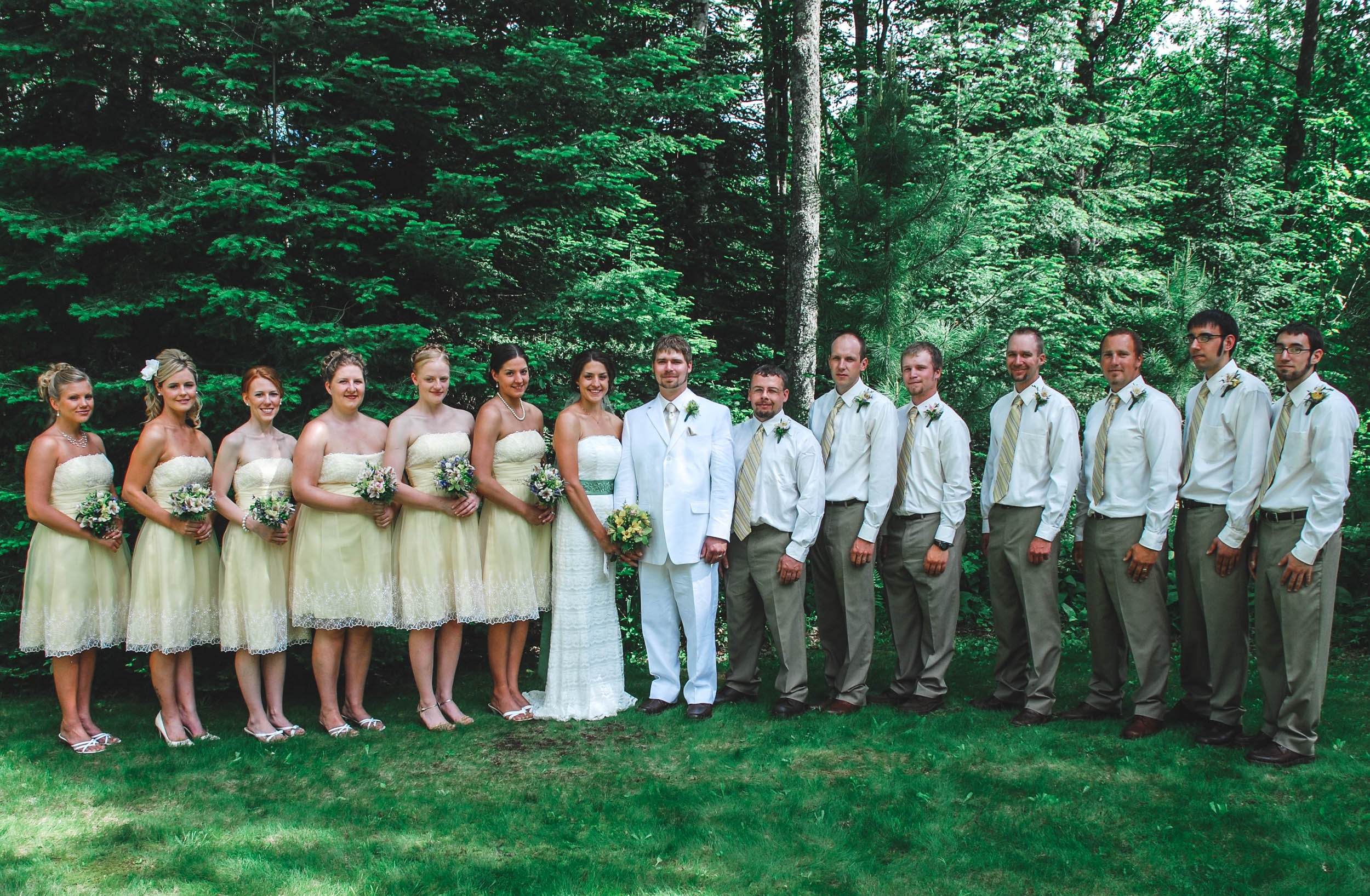 Traditional wedding party pose after backyard Wisconsin ceremony