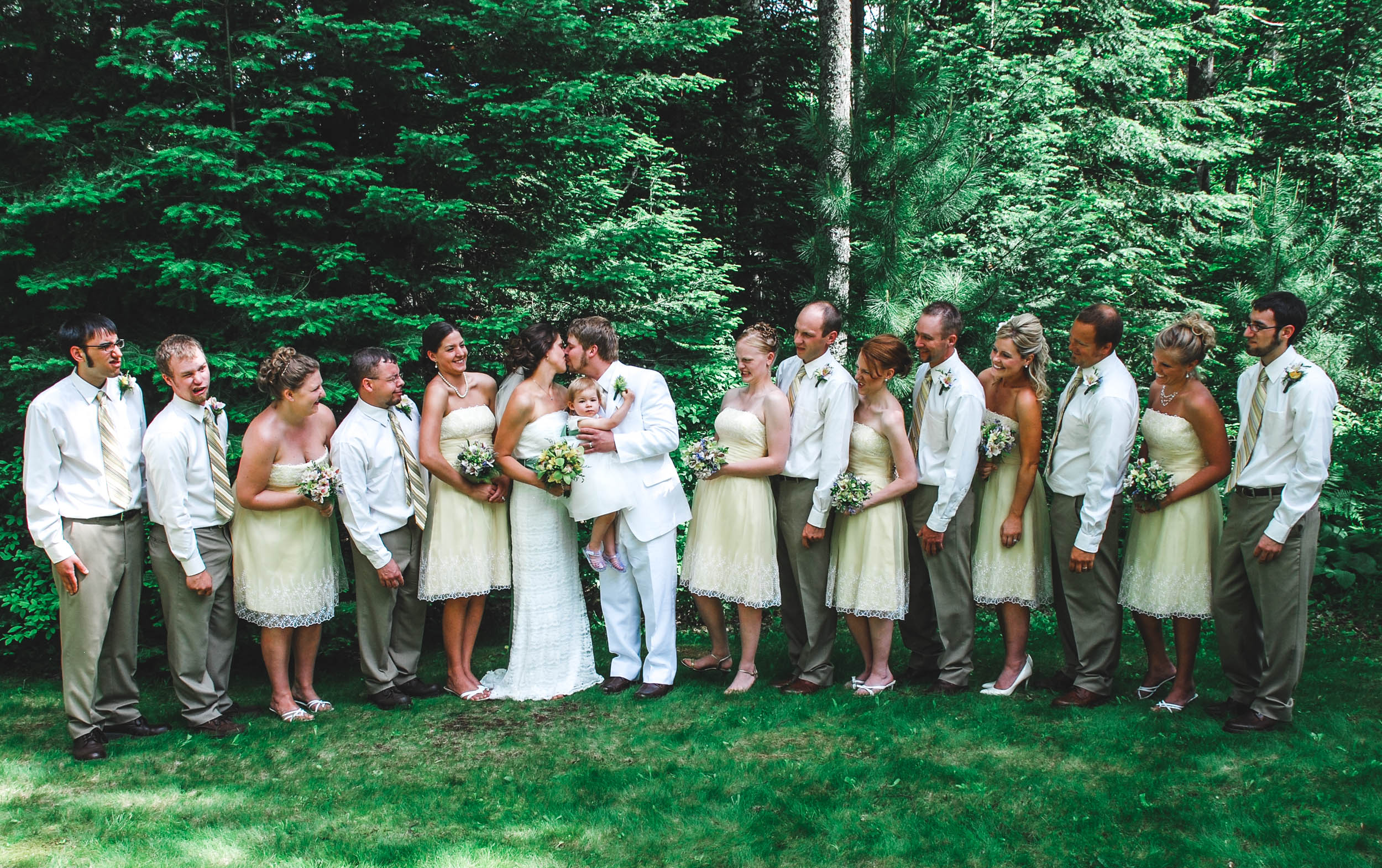 Funny wedding party photo after outdoor wedding