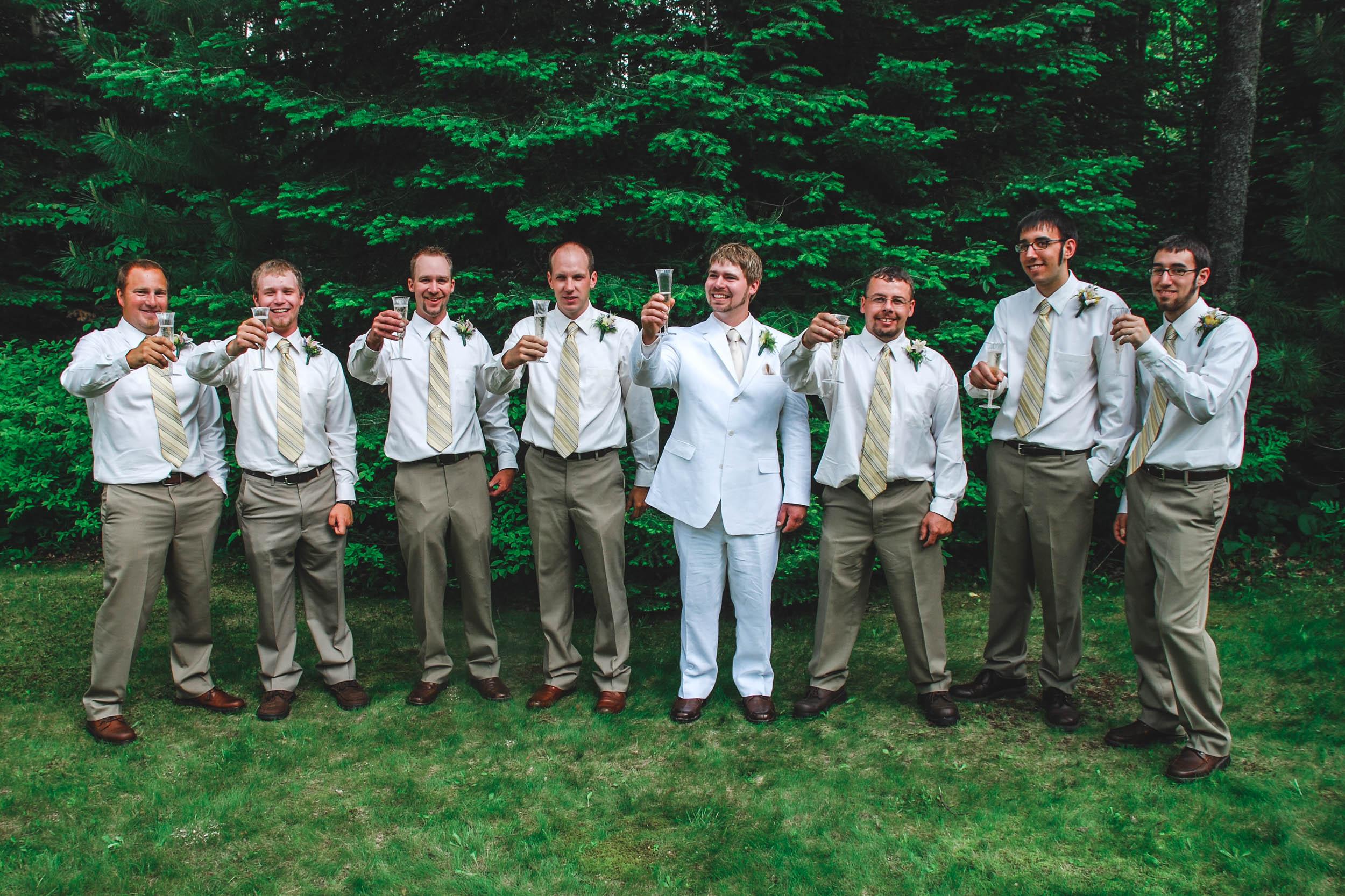 Outdoor wedding; groom and groomsmen