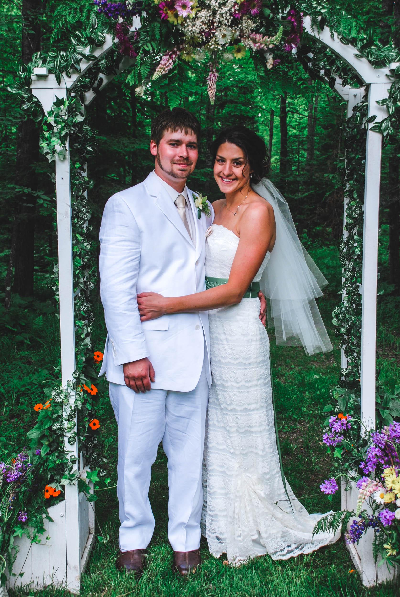 Bride and groom under their Eastern Wisconsin wedding arch