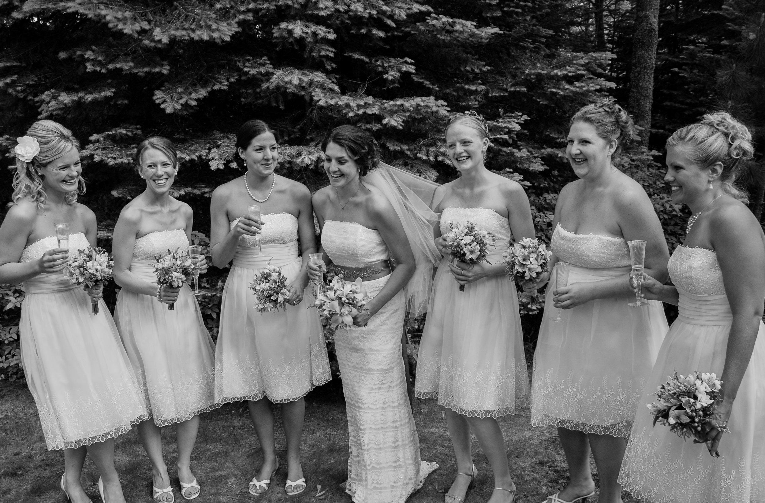 Outdoor wedding; bride and bridesmaids