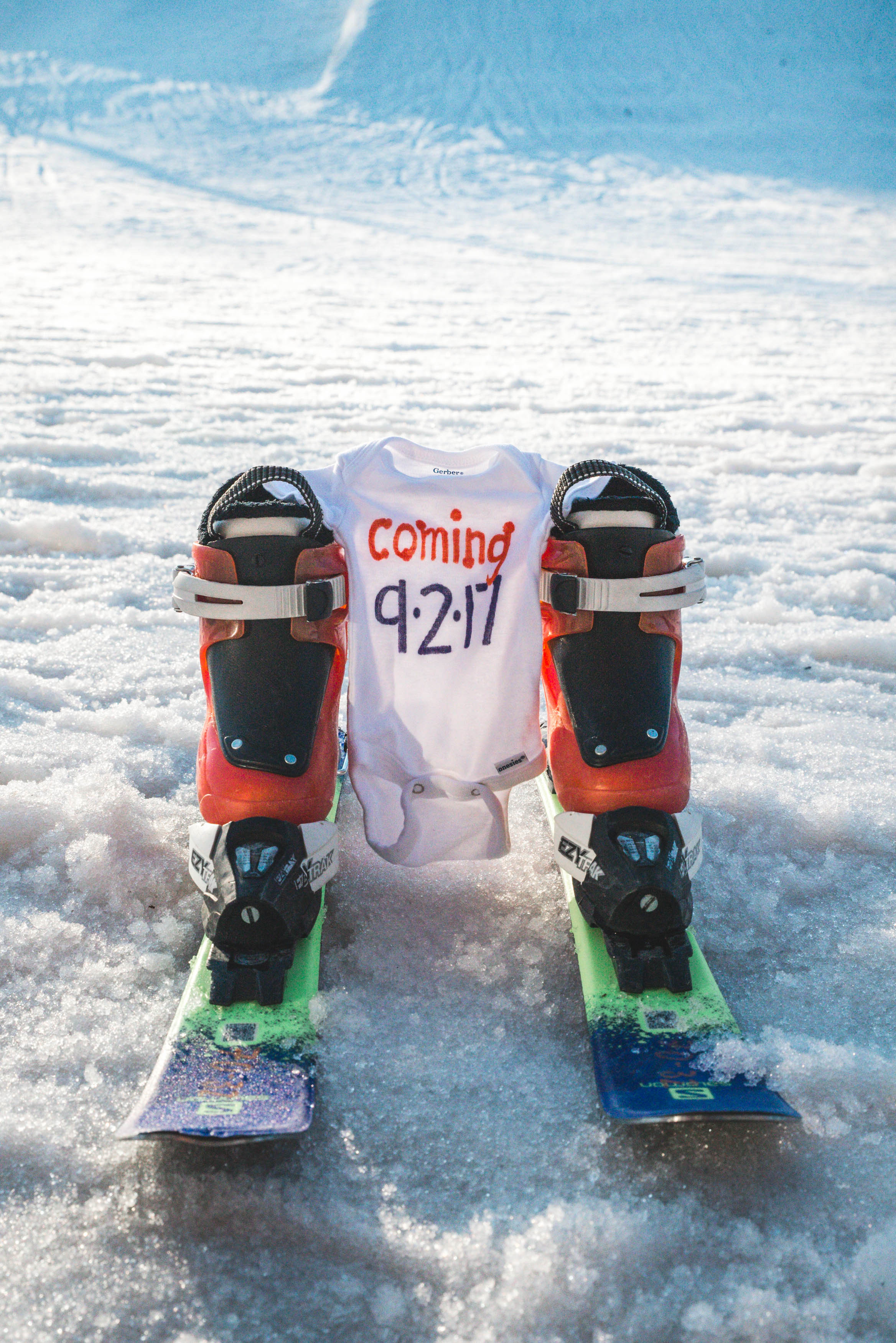 onesie pregnancy announcement skis