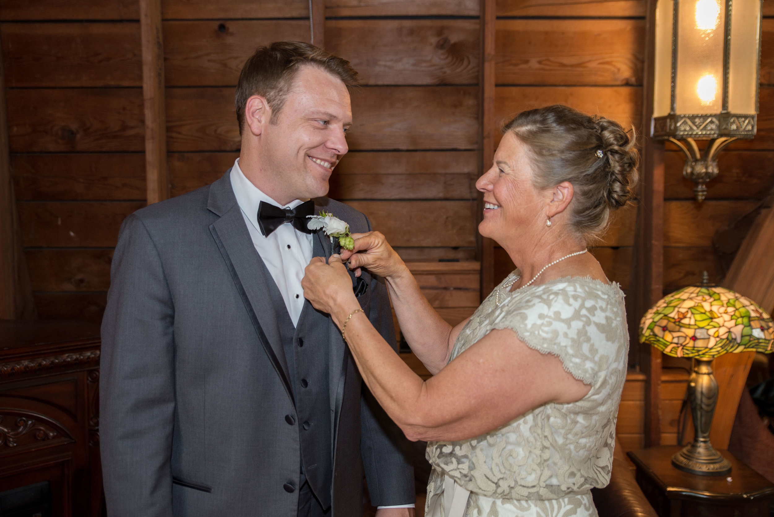 Keegan and his mom share a special moment as she pins his boutonniere. Family photos can encompass anything from specific people you'd like to capture in their requested roles for the day to the full extended family photos!