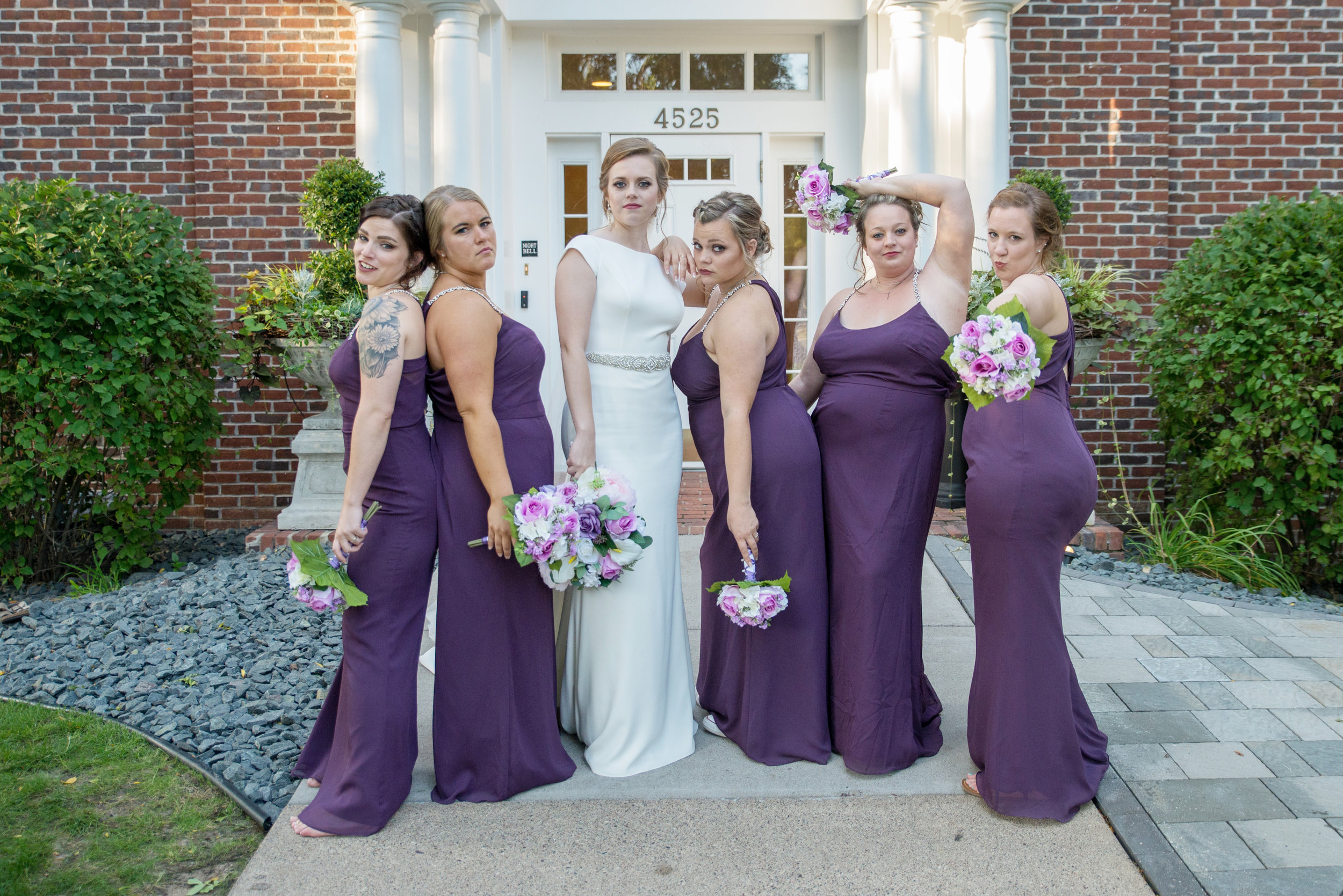 Breanna and her bridesmaids showing some attitude - we'll always get shots of you with your chosen bridal party members, but can split up bridal party shots before and after the ceremony if you opt out of a first look!