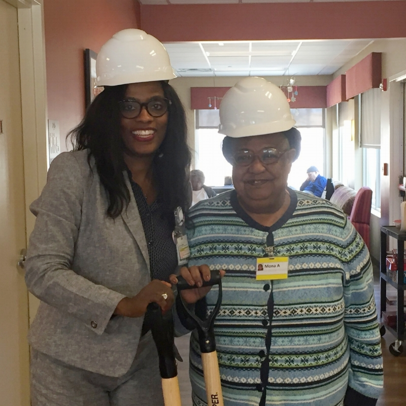 Sonja Felton and patient wearing hard hats and smiling