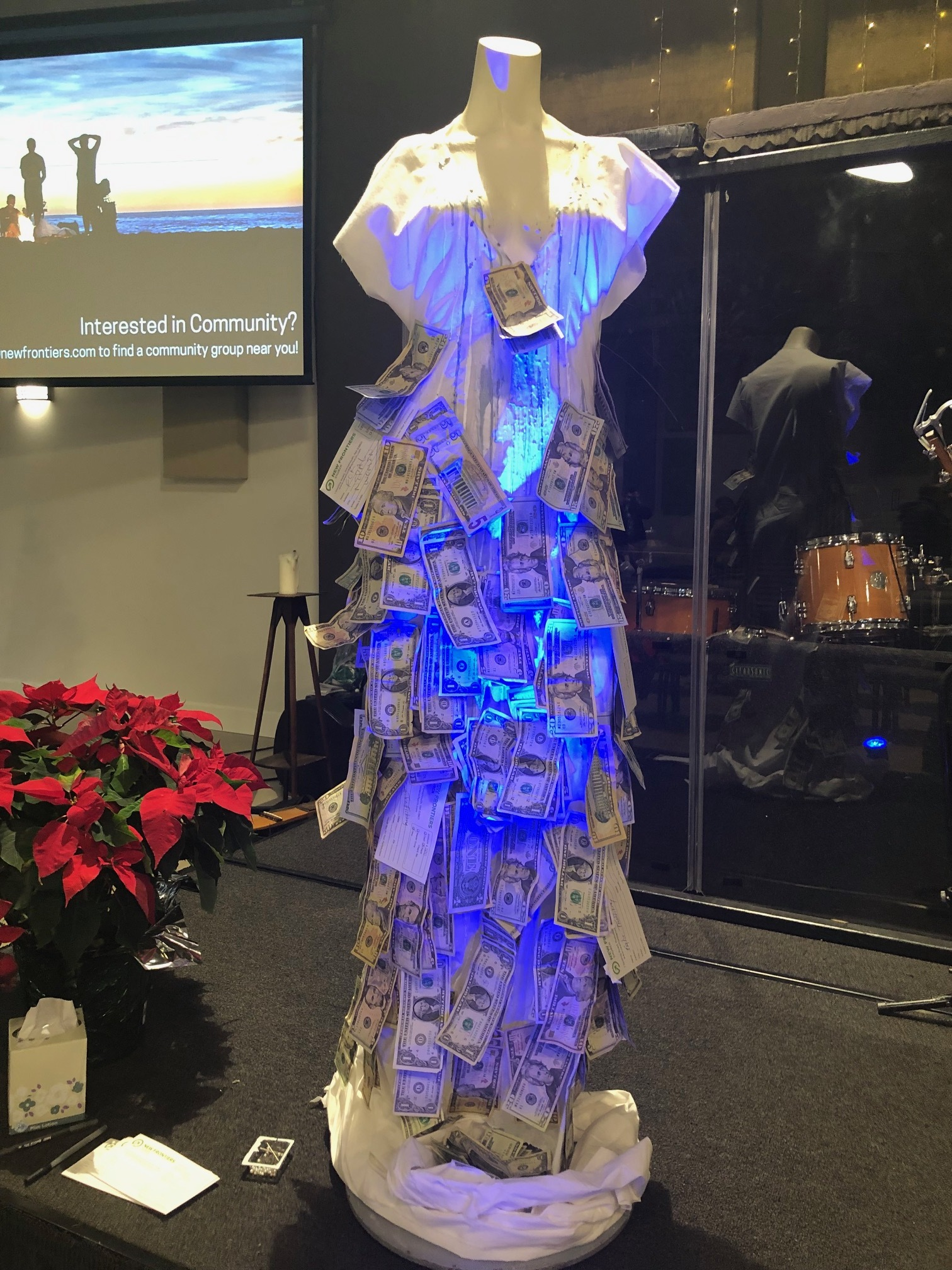 The dress placed on stage at New Frontiers Church to collect funds for James and Sylve.