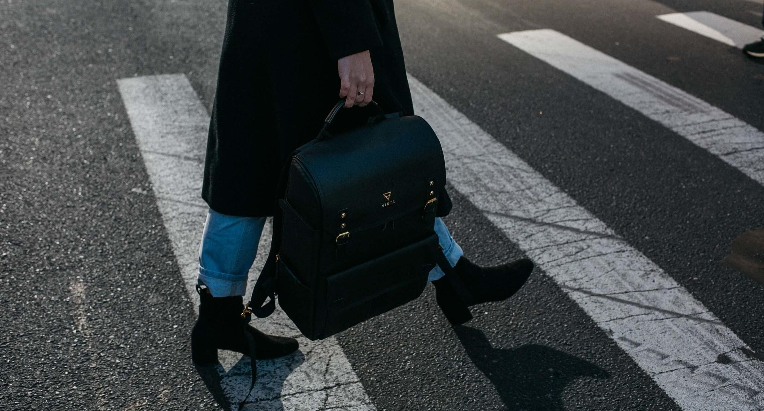 Image: https://www.pexels.com/photo/person-carrying-bag-walking-on-pedestrian-lane-842963/
