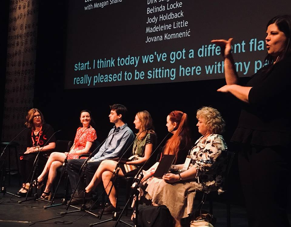 Madeleine Little (second from right) on the  Leading to the Future  panel at Meeting Place 2018 in Alice Springs. From left: Arts Access Australia CEO Meagan Shand, Arts Access Australia Chair Belinda Locke, Dirk Sorge, Jovana Komnenic, Madeleine Little, and Jody Holdback. Photo: Arts Access Australia.