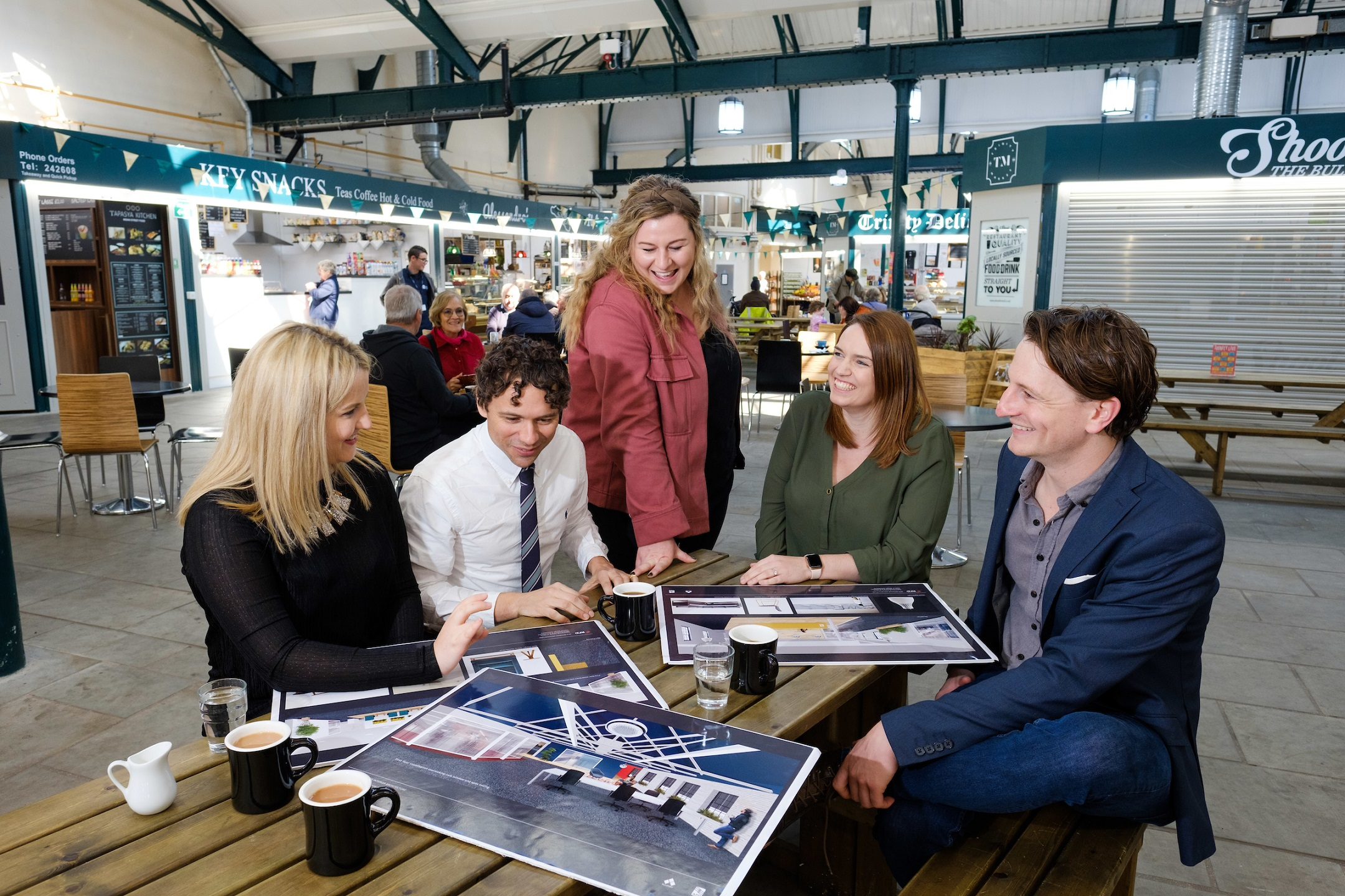 From left, APD's Jane Cross, Alex Jenneson of RFD, Georgia Allenby of Allenby Commercial, APD's Rhiannon Beeson and Allenby Commercial's Charlie Allenby enjoy a relaxing moment in Hull's thriving Trinity Market food hall, which is just yards from APD's new offices.
