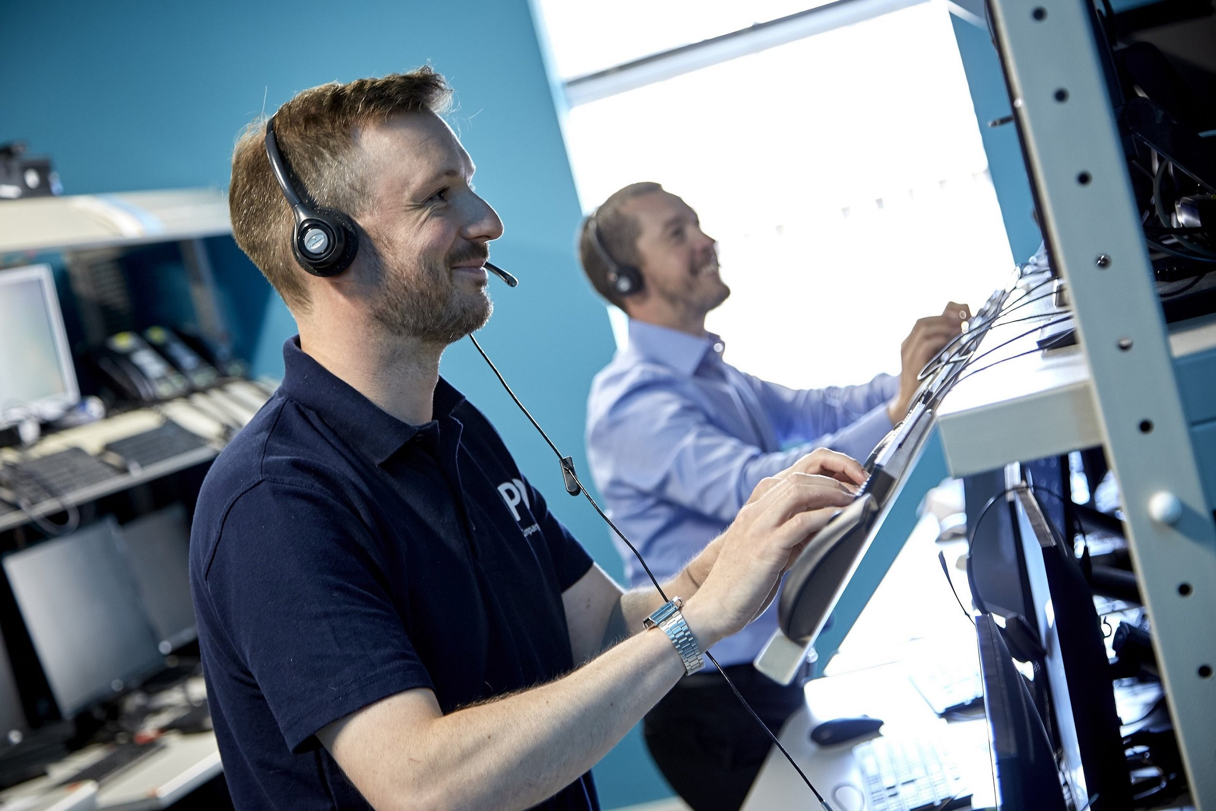 Audio Engineer James Gilby, left, and Senior Software Quality Assurance Engineer Craig Duffy in one of the labs at APD's new Minster Corner offices where systems used by customers in the UK and overseas are tested.