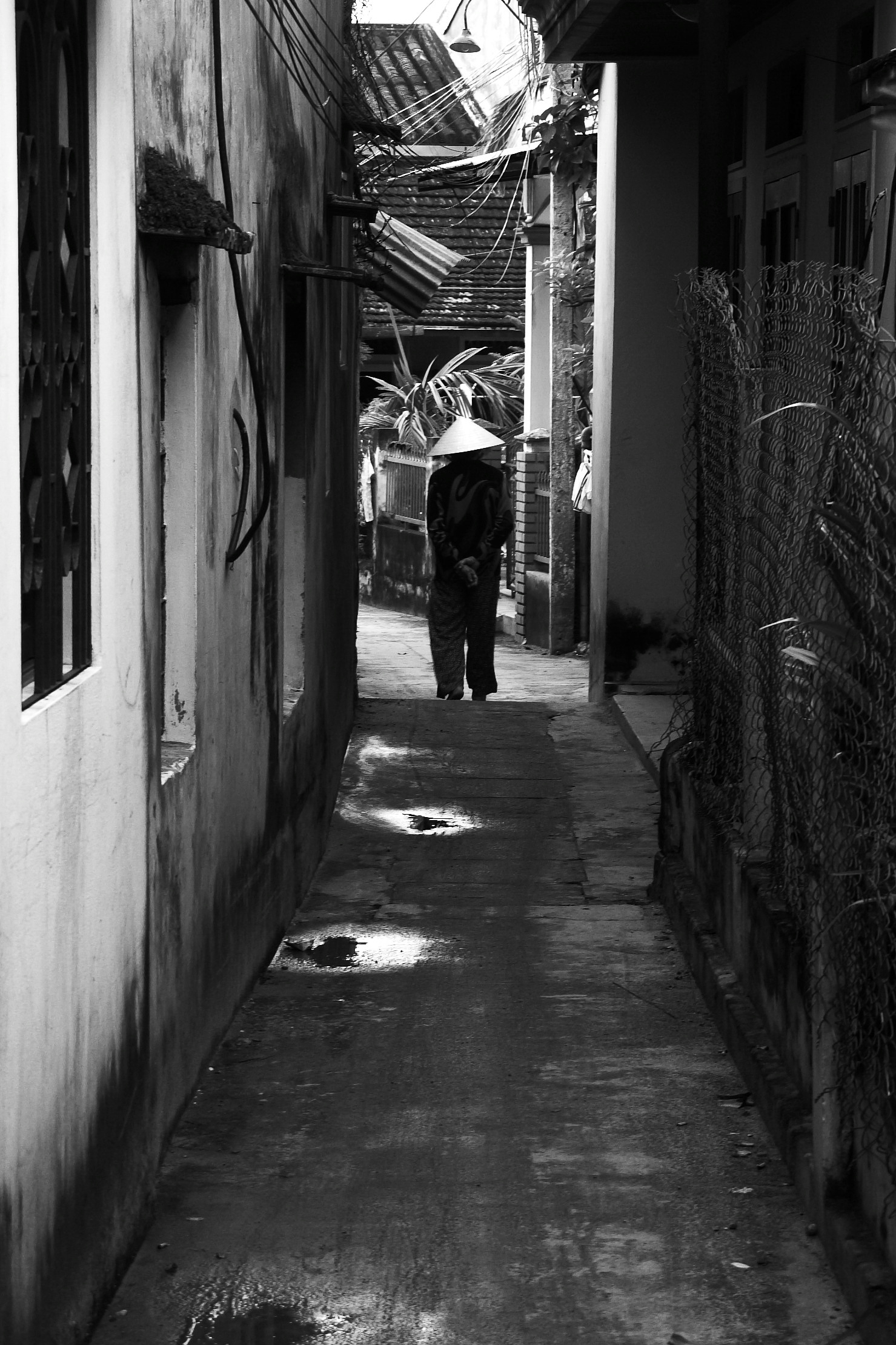 A lady walks home from work. Vietnam