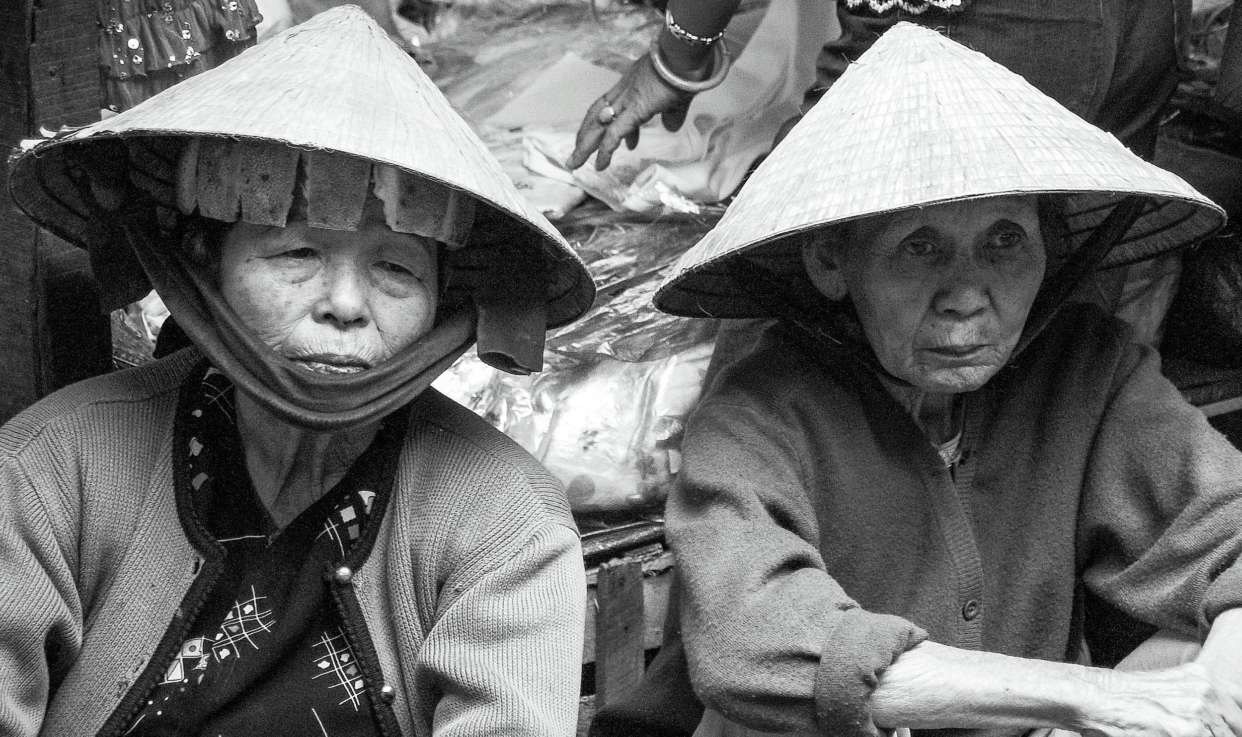 Two women keep an eye on the goings on. Vietnam.