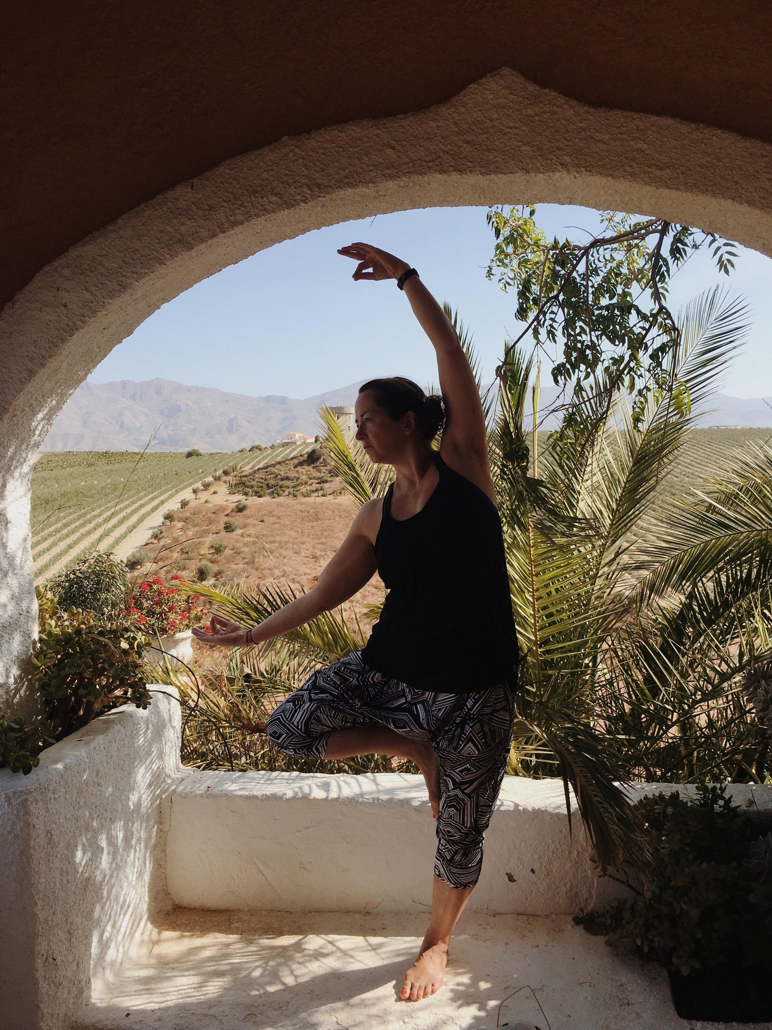 In Spain hosting a yoga retreat.