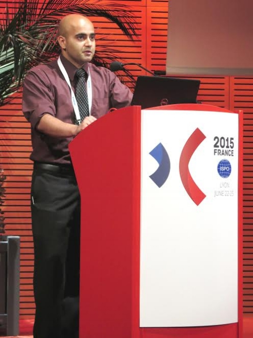 Ali Hussaini presenting at an ISPO conference in France.