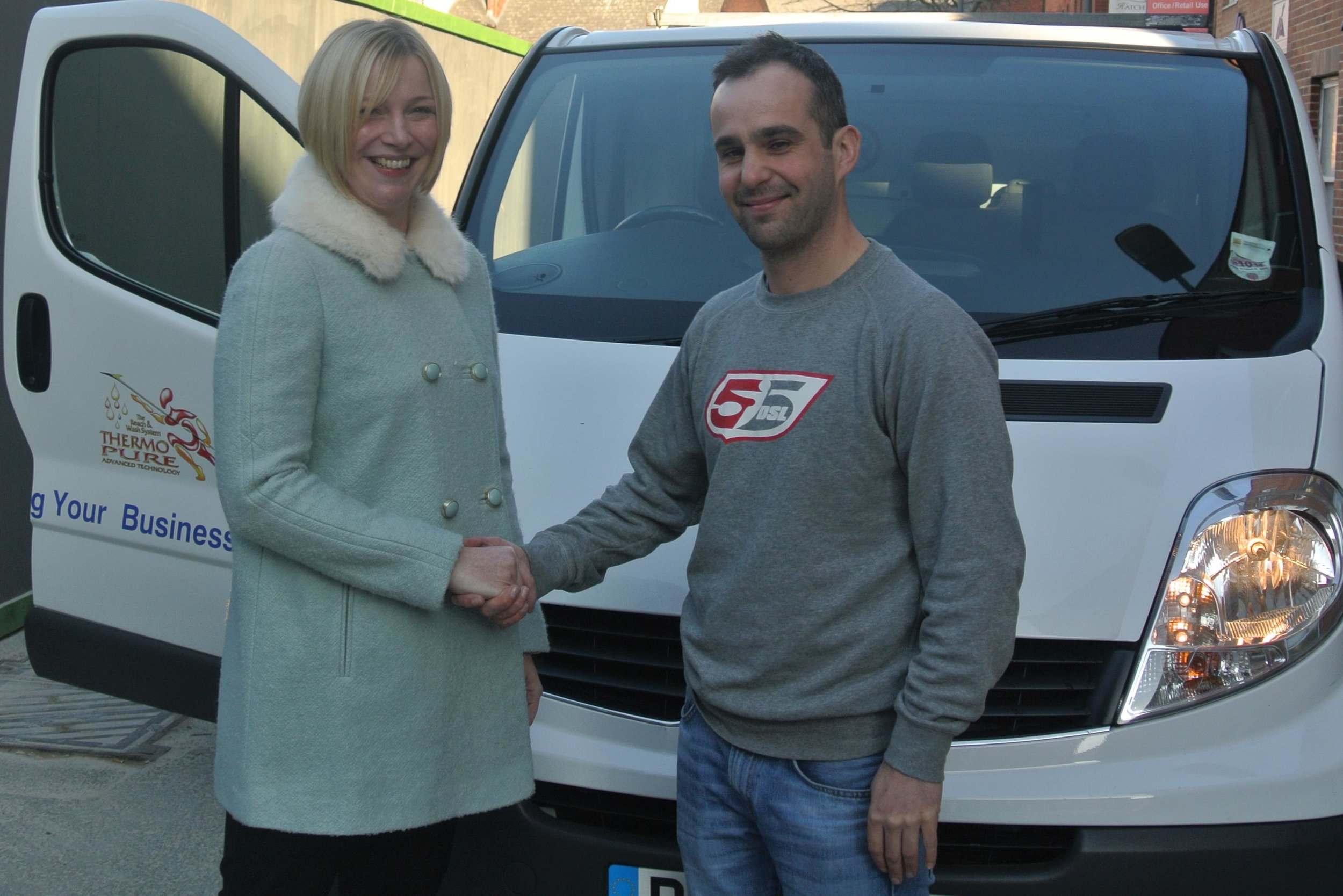 Clare and client shake hands.JPG