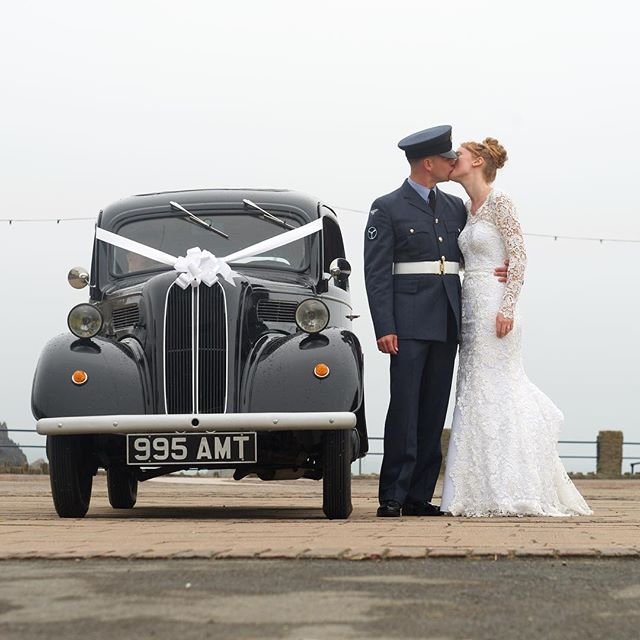 Vintage kisses on the sea front #destinationwedding #vintagewedding #classiccars
