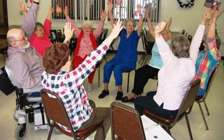 Group of older adults practicing the seated Matter of Balance exercises!