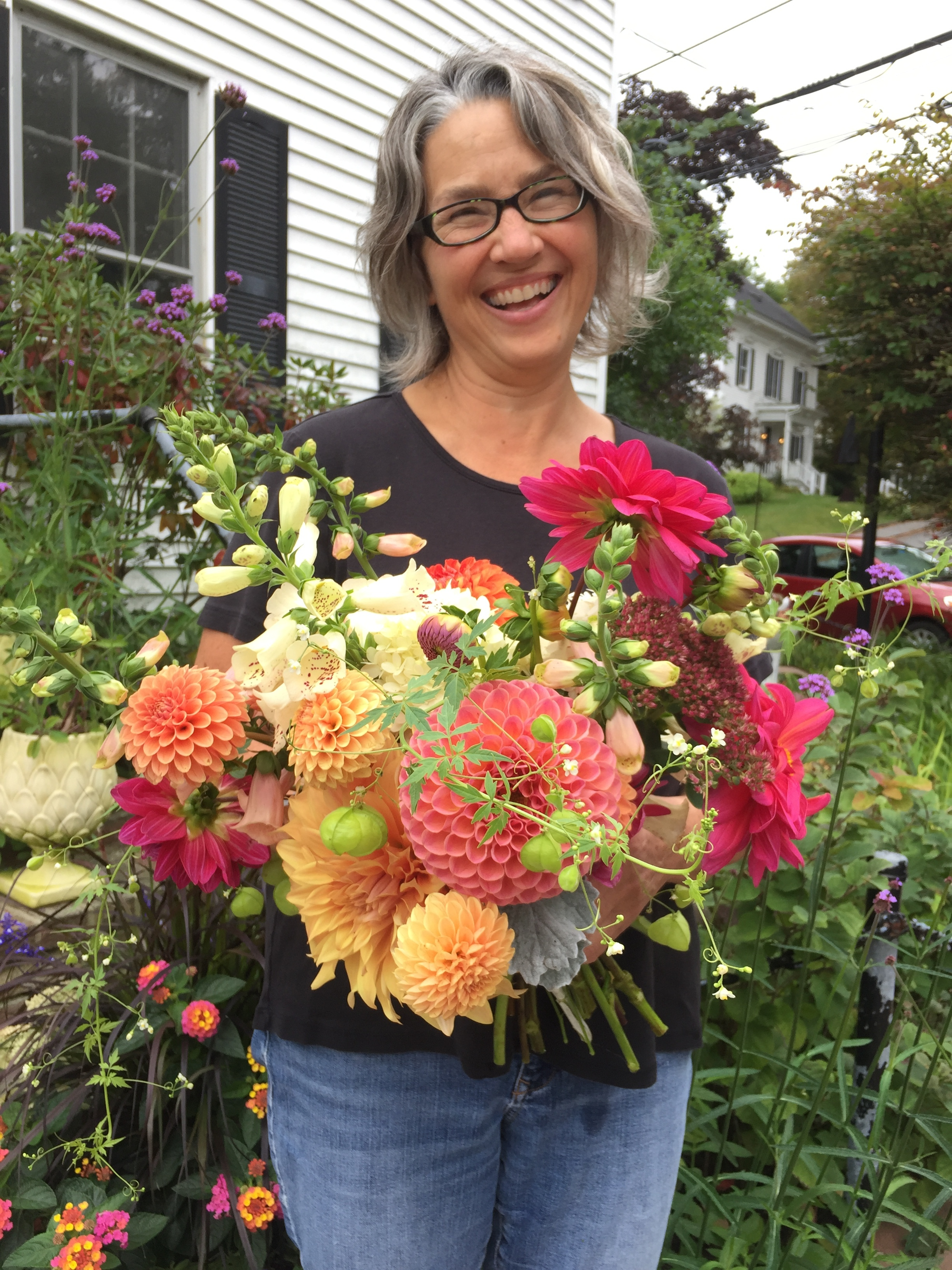 Ione Floral Design created a bodacious English garden styled hand-tied bouquet for our client Genesis Community Fund's recent event.