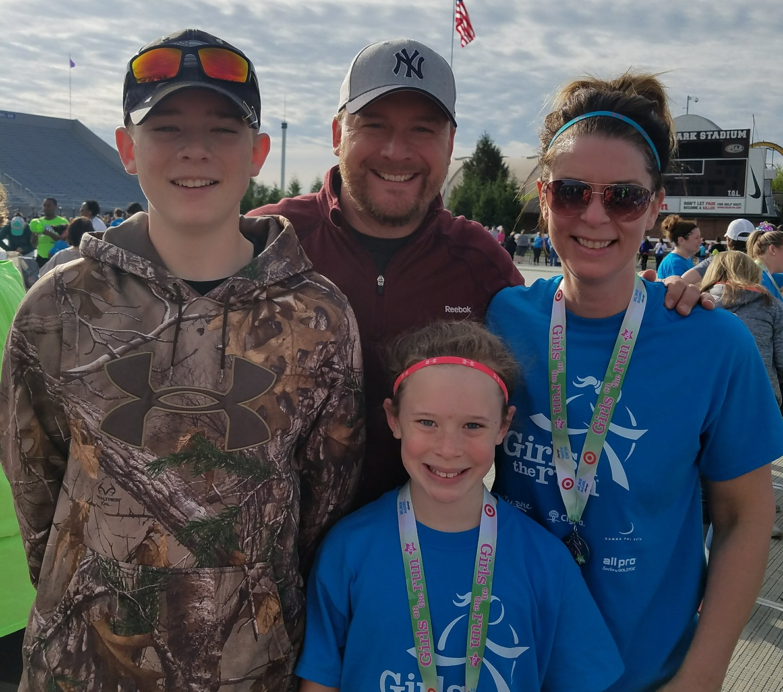 Gretchen and her family after completing the Girls on the Run 5K