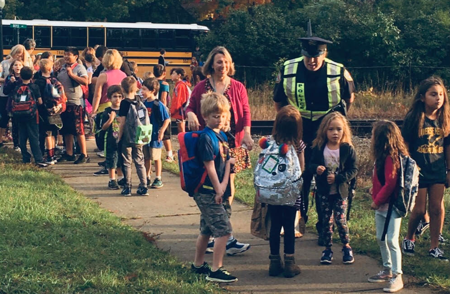 "Students, parent volunteers and law enforcement participate in a ""Walking School Bus,"" one of many ideas to help kids show up at school happy, healthy and ready to learn."