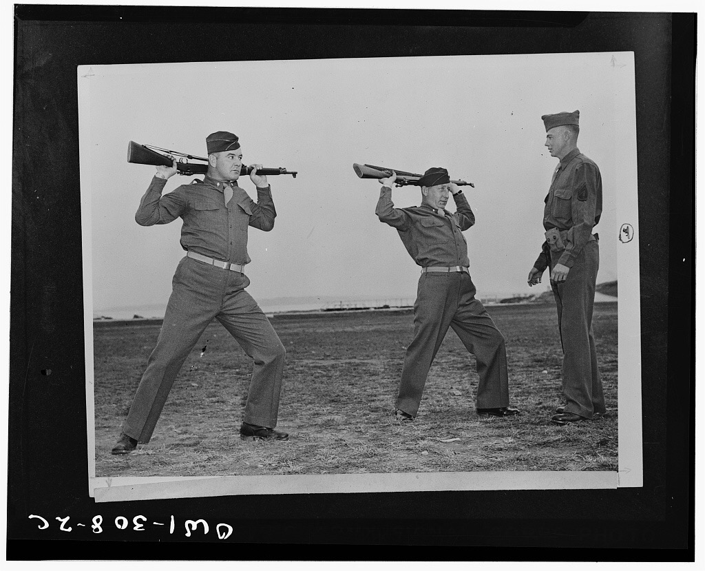 Heavyweight boxing champ James Braddock and his manager Joseph Gould doing rifle calisthenics under instruction from Sergeant John A. Bender, who was accidentally shot by Gould during the photo op.   By U.S. Signal Corps [Public domain], via Wikimedia Commons