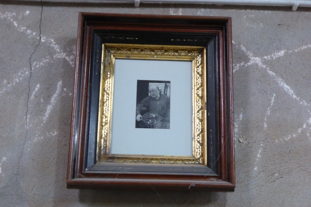 A picture of master glassblower Lino Tagliapietra above the door in Scott's studio