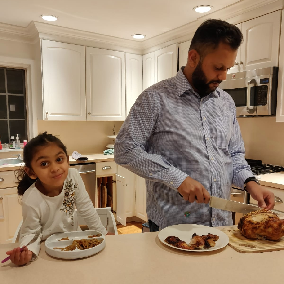 Pearl's husband Alden, the family's 'full-time chef,' is pictured heaping deliciousness into her daughter Naomi's Bumkins    Silicone Grip Dish    in Marble.