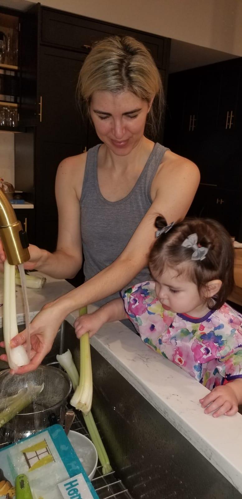 Rachel's daughter is pictured with Bumkins'    Junior Bib    in Watercolor