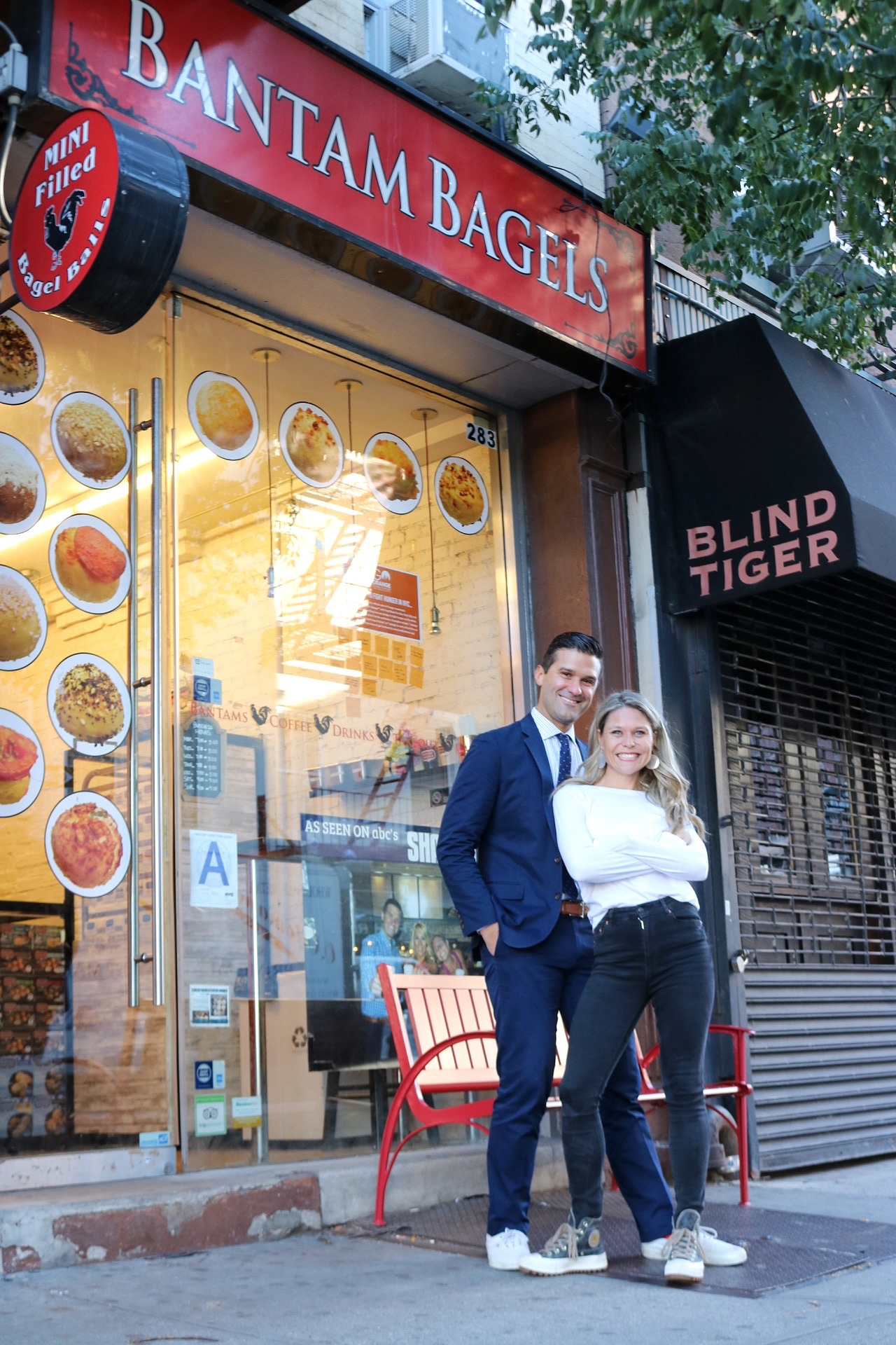 Elyse and Nick outside of their shop on Bleecker Street in New York City.